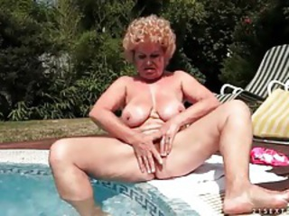 Granny sits poolside and sucks young cock tubes