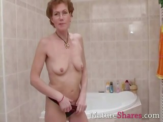 bushy mature pees and gets a shower