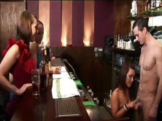 Sluts in a bar get loads of free drinks from the bartender