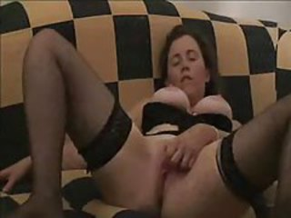 Busty and on the couch rubbing her clit tubes