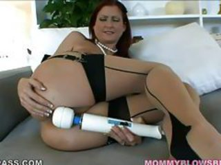 Elegant looking redhead milf sucking on a knob tubes