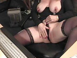 Mature attaches clamps to her nips tubes