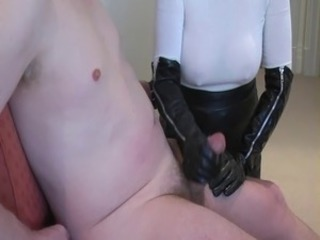 Busty hand job in long leather gloves