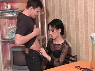 Skinny dark haired transvestite fastening 1