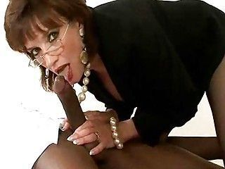 Mature Whore prevalent Glasses and Pearls Has Some Interracial XXX Action