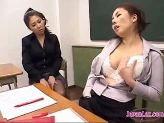 Asian lesbians masturbate and watch each other then suck toes in classroom.
