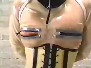 Lesbian femdom babe plays with her leather bound subject
