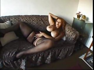 Huge tits girl in a corset and stockings tubes