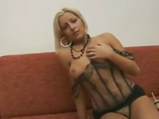She wears corset lingerie and poses solo tubes