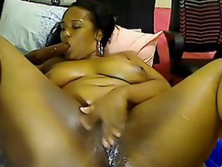 Ebony Squirt Slut is fingering