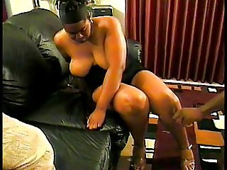 Fat ebony chick spreads her legs for a big cock