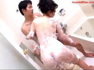 Milf rubbed with soap giving blowjob for young guy in the ba