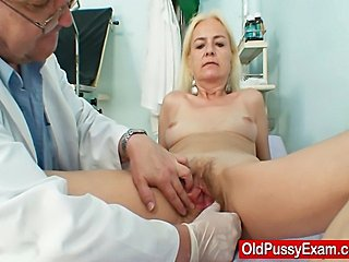 Blond grandma gets her hairy pin-headed age-old vagina opened with a pussy spreader...