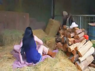 Two chubby mature lesbian cowgirls finger fucking out in the barn