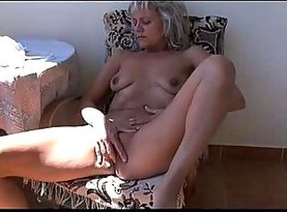 Naughty older Granny masturbating with toy