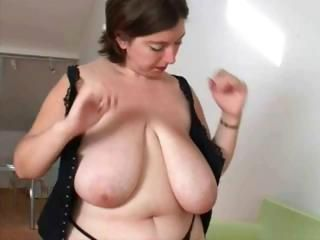 Chubby wife with huge tits is brigandage and posing in excess of cam