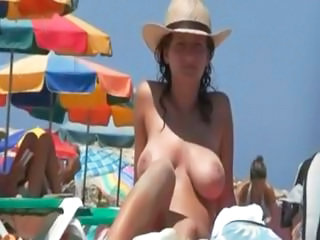 Busty Women Sunbathing Topless By A Pool Or On The Beach Outside