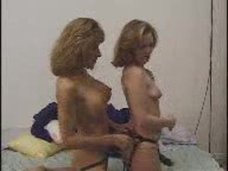 Wife And Neighbor With A Strap-on