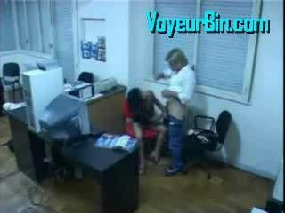 Couple fucking at the office