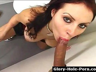 Busty hottie blows cock in glory hole