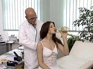 Pretty long-haired brunette gets rammed by randy doc on a medical couch