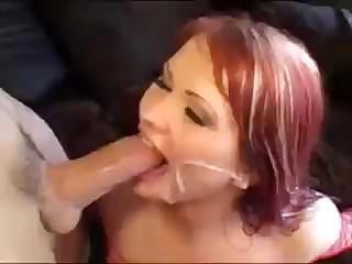 Redhead wears sexy red fishnet and fucks and gets a facial