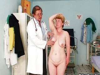 Mature housewife taking her clothes