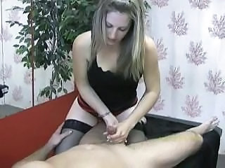 Masseuse looks focused as she masturbates her client's cock