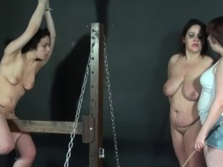 Wooden horse bound and palm  of 2 caned lesbo serf females inside explicit...