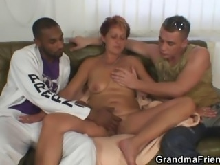 Naughty grandma takes two dicks at once