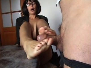 footjob on table