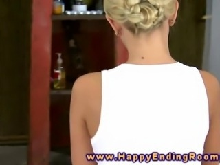 Blonde massage beautie rubs clients clit