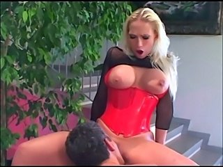 Big boobed blonde babe fucked in boots and corset