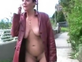 Mature exhibitionist masturbating in public and squirting on pavements by old...