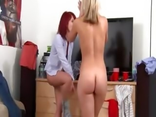 Two young androgynous girls sucking penis