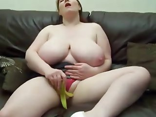 Redhead chubby woman shows and masturbates with fruit