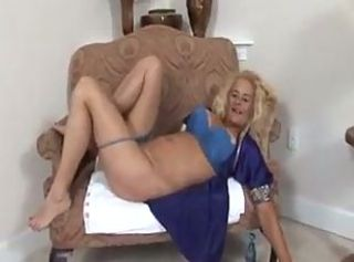 Blonde mature bitch shoves huge dildos in her wide vagina.