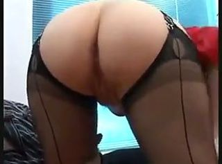 Busty Redhead in Nylons uses her tits hands and feet