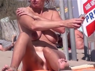 French nudist beach Cap d'Agde sunbath pussy spread legs 03