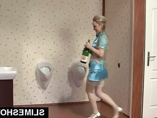 Blonde Girl Riding Champain Bottle In Toilet
