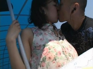 Asian Girlfriend Kissing Outdoor Public