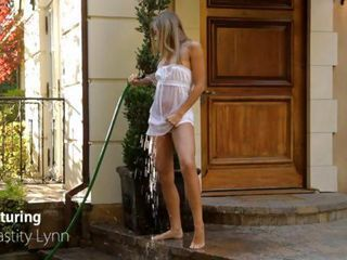 Petite blonde Chastity Lynn brings ultimate pleasure to her hot pussy with a cool stream of water from the garden hose