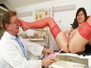 kinky gyno doctor fingers vagina of attractive dark haired