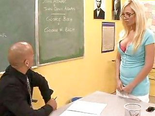 Busty blonde in sexy glasses fucks in a classroom settings