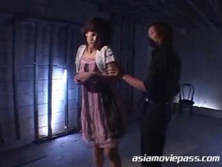 Asian babe held in a rough bondage. She was tied up. Her face and body was clipped. She was also wax tortured and spanked. Her asshole injected with some white fluid and pounded with dildo.