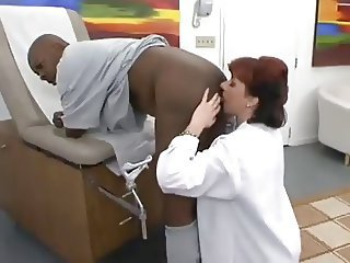 Busty Redhead Doctor Plays with Sulky Patient