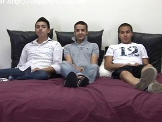 Boys Justin, Cade And Geof Sit On Bed