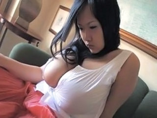 Innocent asian babe with mega tits