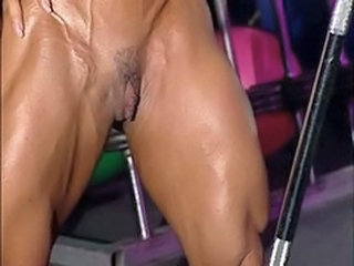 bodybuilder adult in training center with high heels