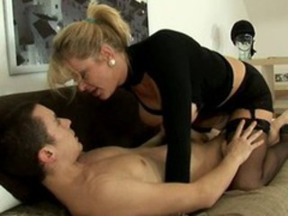"Sexy milf in black and a younger guy"" target=""_blank"